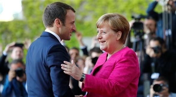 المستشارة الألمانية آنجيلا ميركل والرئيس الفرنسي إيمانويل ماكرون (أرشيف)