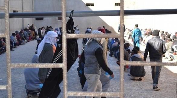 مهاجرون في مركز احتجاز في ليبيا (أرشيف)