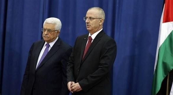 رئيس الحكومة الفلسطينية المستقيل رامي الحمدلله والرئيس محمود عباس (أرشيف)