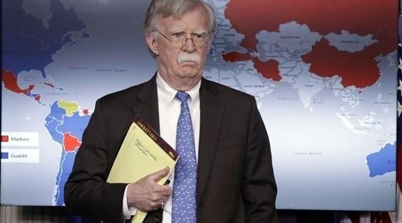 مستشار الأمن القومي الأمريكي جون بولتون ومفكرته الصفراء (أ ب)