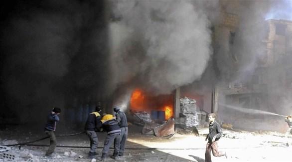مدنيون في الموصل بعد ضربة جوية شنها التحالف الدولي (أرشيف)