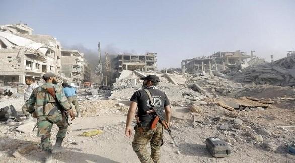 مقاتلان من قسد في آخر معقل لداعش بدير الزور في سوريا (أنسا)