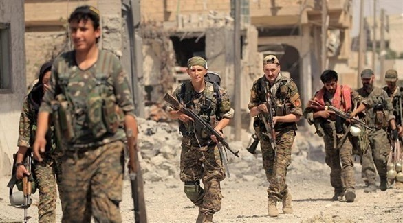 مجموعة عسكرية من قوات سوريا الديمقراطية في منطقة الباغوز (أرشيف)