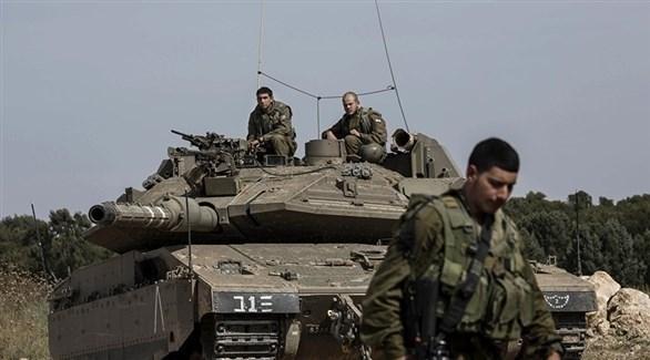 دبابة وجنود إسرائسيليون على الحدود مع غزة (أرشيف)