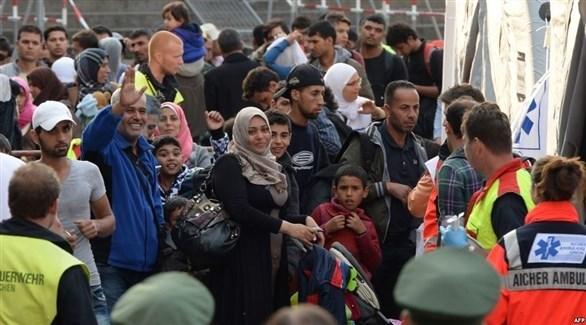 لاجئون أثناء استقبالهم في ألمانيا (أ ف ب)