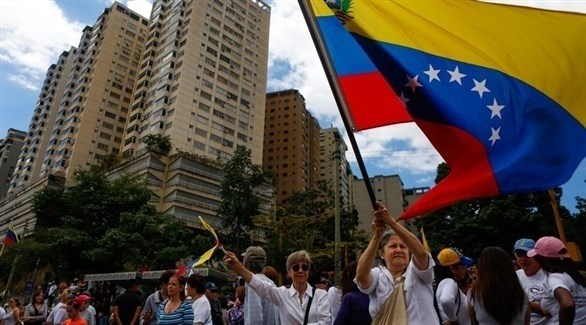 فنزويليتان في مسيرة مناهضة لمادورو  (إ ب أ)