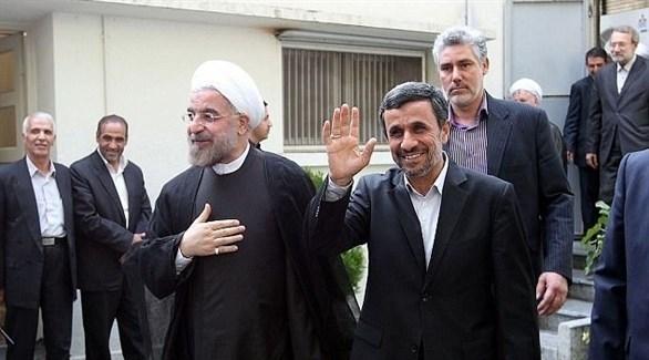 الرئيسان الإيرانيان السابق محمود أحمدي نجاد والحالي حسن روحاني (أرشيف)