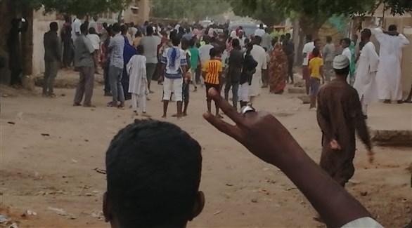 متظاهرون في السودان (أ ف ب)