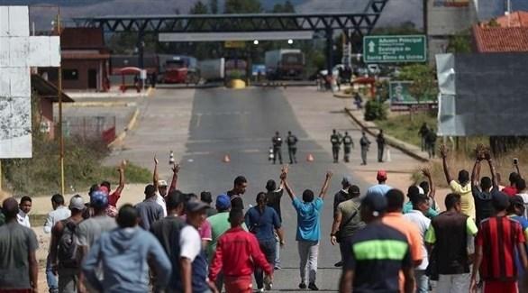 اشتباكات بين سكان محليين وقوات الأمن على الحدود بين كولومبيا وفنزويلا (د.ب.أ)