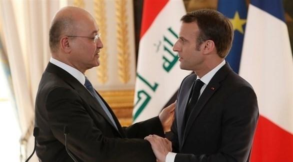 الرئيسان الفرنسي إيمانويل ماكرون والعراقي برهم صالح (إ ب أ)
