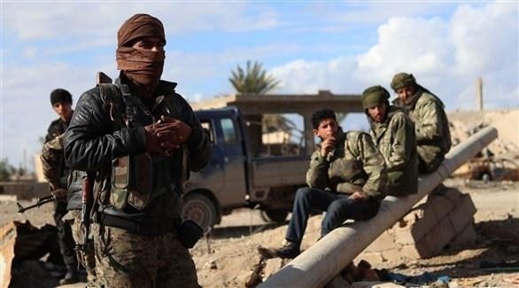 عناصر مسلحة من تنظيم قوات سوريا الديمقراطية (أ ف ب)