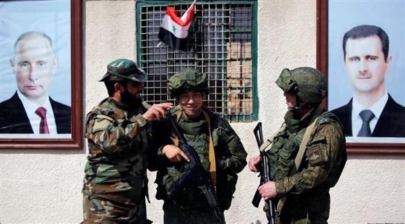 صورا الأسد وبوتين مع عدد من الجنود (أرشيف)