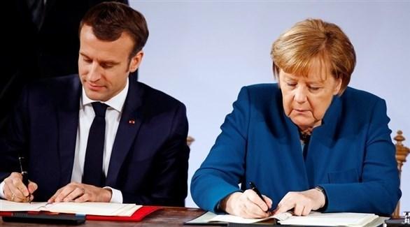 الرئيس الفرنسي إيمانويل ماكرون والمستشارة الألمانية أنغيلا ميركل(أرشيف)