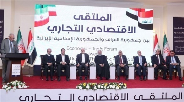 الرئيس الإيراني حسن روحاني ورئيس الوزراء العراقي خلال الملتقى الاقتصادي التجاري (أرشيف)