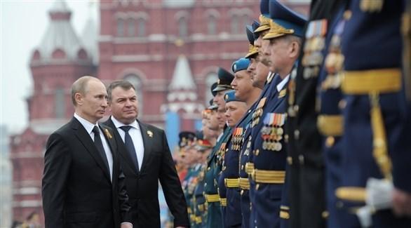 الرئيس الروسي فلاديمير بوتين خلال احتفالات ضم جزيرة القرم (أرشيف)