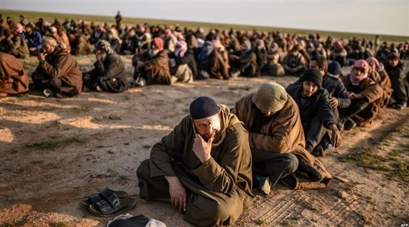 مقاتلون من تنظيم داعش بعد استسلامهم في الباغوز السورية (أرشيف)