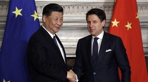 رئيس الحكومة الايطالي جوسيبي كونتي والرئيس الصيني شي جي بينغ (أ.ف.ب)