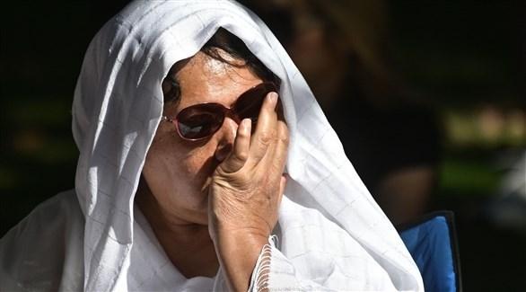 امرأة تبكي ضحايا الهجوم في نيوزيلندا (أ ف ب)
