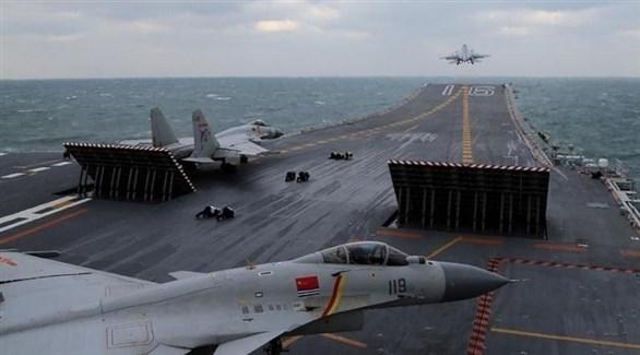 مقاتلات صينية على متن حاملة طائرات في بحر الصين الجنوبي (أرشيف)