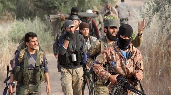 مسلحون من المعارضة السورية في إدلب (أرشيف)