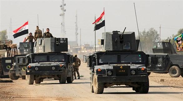 ناقلات جنود ومدرعات عراقية على الحدود مع سوريا (أرشيف)