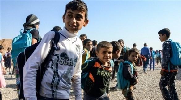 أطفال عراقيون في مخيم نازحين جنوب الموصل (أرشيف)