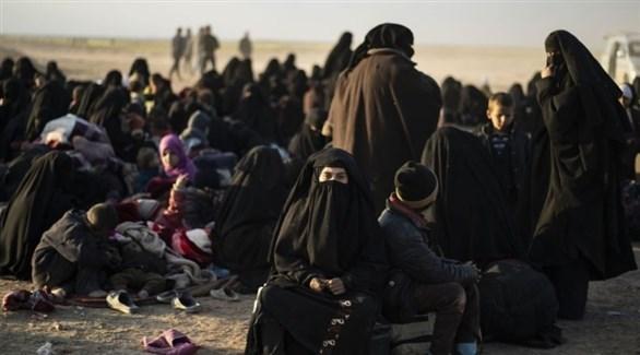 نساء داعش وأطفالهن في مخيم الهول (أ ف ب)