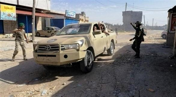مسلحون في إحدى شوارع العاصمة الليبية طرابلس (أرشيف)