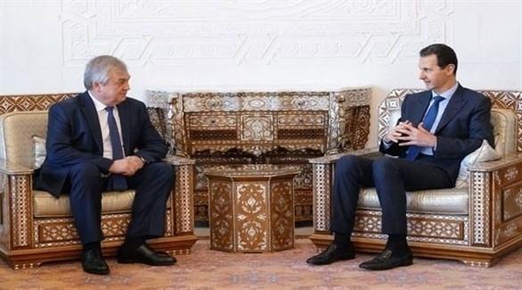 بشار الأسد ومبعوث الرئيس الروسي إلى سوريا ألكسندر لافرنتييف (تويتر)