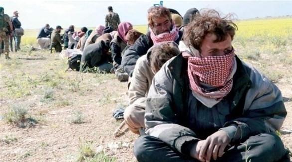 معتقلون من داعش بعد معركة الباغوز (الشرق الأوسط)
