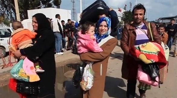 عائات ليبية فارة من طرابلس بسبب استمرار الاشتباكات (أرشيف)