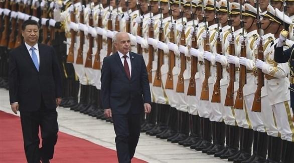 الرئيس الصيني شي جين بينغ مستقبلاً الرئيس السويسري أولي مورير في بكين (أرشيف)