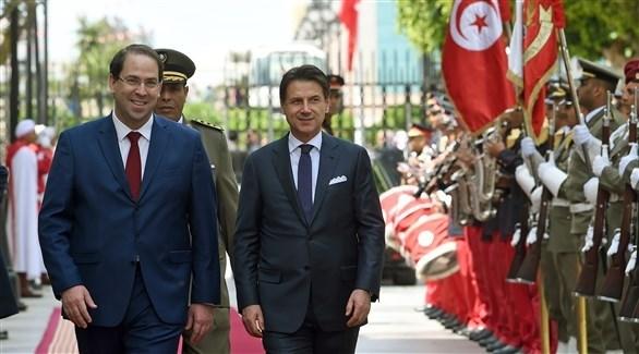 رئيس الوزراء الإيطالي جوزيبي كونتي ونظيره يوسف الشاهد (أ ف ب)