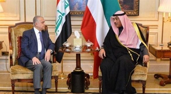 نائب رئيس الوزراء وزير الخارجية الكويتي الشيخ صباح الحمد الصباح ووزير الخارجية العراقي محمد الحكيم (كونا)