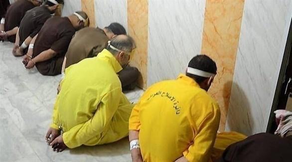 سجناء ينتظرون المحاكمة بتهمة الانتماء لتنظيم داعش الإرهابي في العراق (أرشيف)