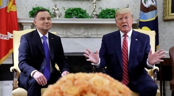 الرئيس الأمريكي دونالد ترامب ونظيره البولندي اندريه دودا (رويترز)