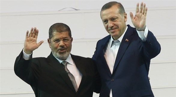 الرئيس التركي رجب طيب أردوغان والإخواني الراحل محمد مرسي (أرشيف)