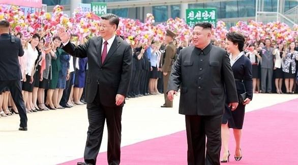 الرئيسان الصيني شي جين بينغ والكوري الشمالي كيم جونغ أون (أرشيف)