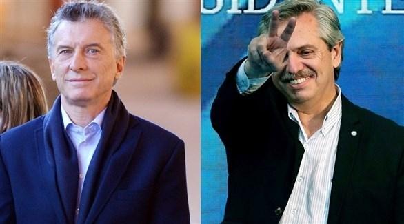 الرئيس الأرجنتيني المنتهية ولايته ماوريسيو ماكري ومنافسه ألبيرتو فرنانديز (أرشيف)