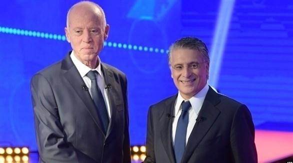 المرشحان لرئاسة تونس نبيل القروي وقيس سعيد (أ ف ب)