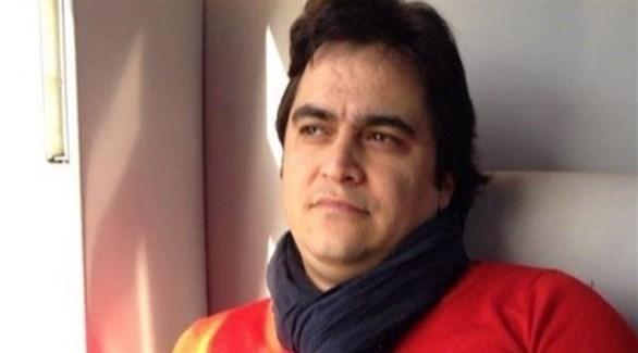 الصحافي الإيراني المعارض روح الله زم (تويتر)