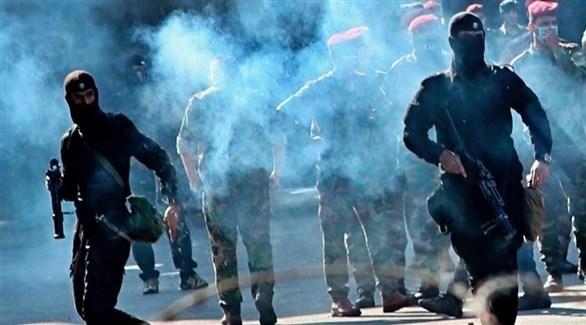 قوات أمن عراقية تطلق قنابل الغاز المسيل للدموع على المتظاهرين في بغداد (أرشيف)