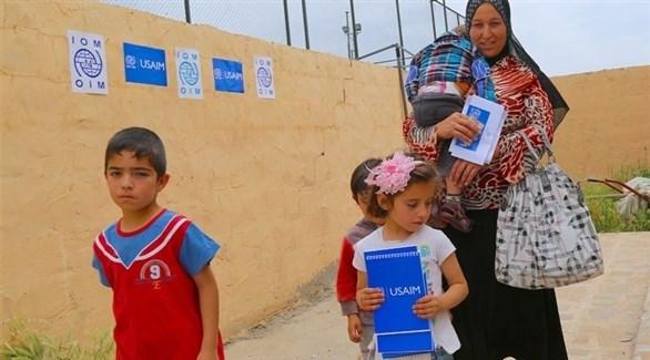 لاجئة سورية وأطفالها في أحد مخيمات كردستان العراق (أرشيف)