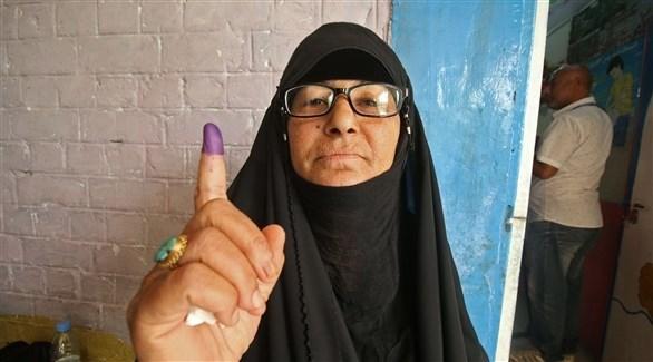 عراقية بعد الإدلاء بصوتها في انتخابات سابقة(أرشيف)