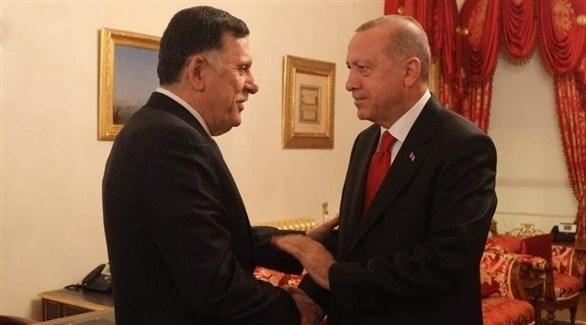 أردوغان وفايز السراج (أرشيفية)
