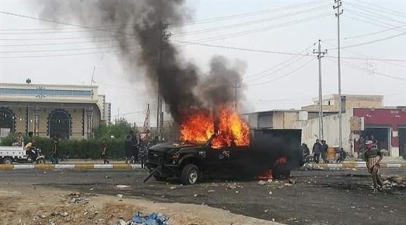 متظاهرون يقطعون الطريق لمقر مركز شرطة ذي قار (أرشيف)