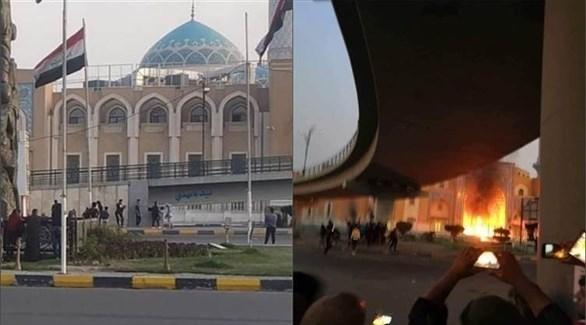 حرق المتظاهرين لمرقد المرجع الحكيم في النجف (أرشيف)