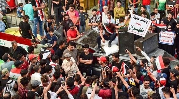 متظاهرون في العراق ضد الفساد (أ ف ب)