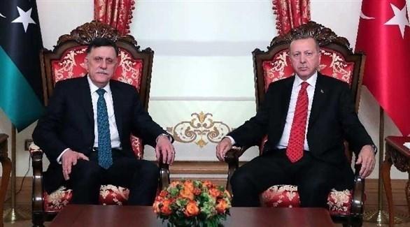 الرئيس التركي رجب طيب أردوغان ورئيس حكومة الوفاق في طرابلس فائز السراج (أرشيف)
