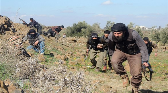 عناصر من جيش خالد بن الوليد المبايع لتنظيم داعش الإرهابي في سوريا (أرشيف)